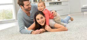 young family playing on the carpet